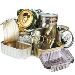A stack of recyclable metals including tin and aluminum cans.