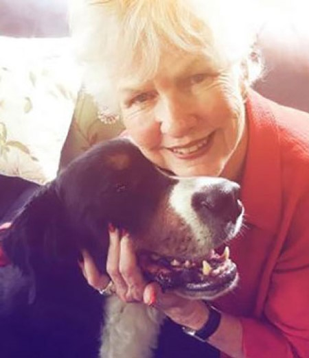 Nebraska author Joy Johnson Brown poses with a canine friend