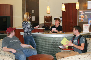 Students visiting in lobby of Columbus Campus West Residence Hall.